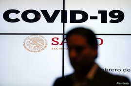 "A screen displays the term ""Covid-19"" as Hugo Lopez-Gatell Ramirez (not pictured), Mexico's Undersecretary of Health Prevention…"