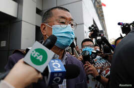 Media mogul and Apple Daily founder Jimmy Lai Chee-ying leaves from a police station after being arrested for illegal assembly…