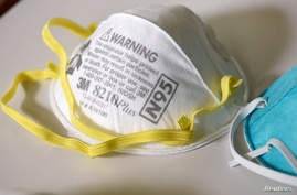 Various N95 respiration masks at a laboratory of 3M, that has been contracted by the U.S. government to produce extra marks in…