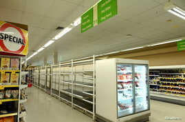 Empty shelves are seen after customers stocked up on toilet paper during swirling fears around the coronavirus in Sydney,…