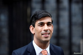 FILE PHOTO: Newly appointed Britain's Chancellor of the Exchequer Rishi Sunak leaves Downing Street in London, Britain February…