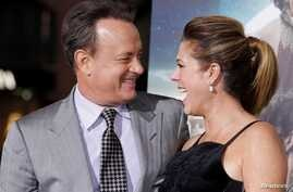 "FILE PHOTO - Actor Tom Hanks, one of the stars of the new film ""Cloud Atlas,"" poses with wife, actress Rita Wilson, as they…"