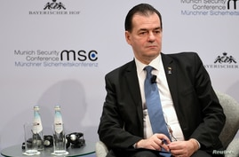 FILE PHOTO: Romania's Prime Minister Ludovic Orban listens during a panel discussion at the annual Munich Security Conference…