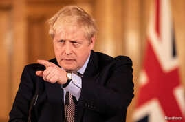 Britain's Prime Minister Boris Johnson speaks during a news conference on the ongoing situation with the coronavirus disease …