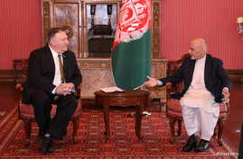 Afghanistan's President Ashraf Ghani (R) meets with U.S. Secretary of State Mike Pompeo in Kabul, Afghanistan March 23, 2020…