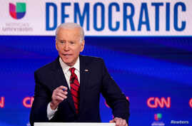 FILE PHOTO: Democratic U.S. presidential candidate and former Vice President Joe Biden speaks during the 11th Democratic…