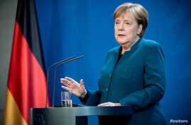 FILE PHOTO: German Chancellor Angela Merkel gives a media statement on the spread of the new coronavirus disease (COVID-19) at…
