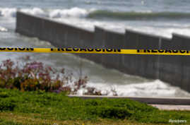 A police cordon tape is seen near the beach and the Mexico-U.S. border fence, after municipal beaches are closed as part of…