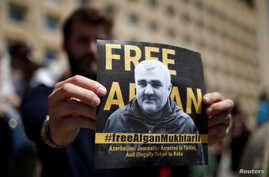 A man attends a rally to support an Azerbaijani Journalist Afgan Mukhtarli, who was abducted in Tbilisi on May 29 and now is in…