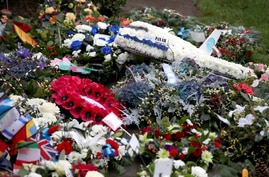 Floral tributes left at the Memorial Garden in Dryfesdale Cemetery, are seen on the morning of the 30th anniversary of the…