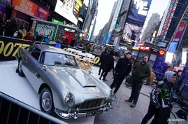 """An Aston Martin DB5 is pictured during a promotional appearance on TV in Times Square for the new James Bond movie """"No Time to…"""