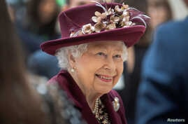 FILE PHOTO: Britain's Queen Elizabeth II talks with MI5 officers during a visit to the headquarters of MI5, which is the United…