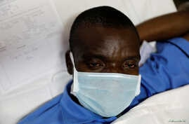 A mock coronavirus patient waits to be transported during an exercise simulating the treatment of a large number of patients…