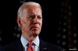 FILE PHOTO: Democratic U.S. presidential candidate and former Vice President Joe Biden speaks about responses to the COVID-19…
