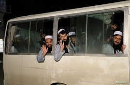 Newly freed Taliban prisoners are seen inside a bus at Bagram prison, north of Kabul, Afghanistan April 11, 2020. Picture taken…