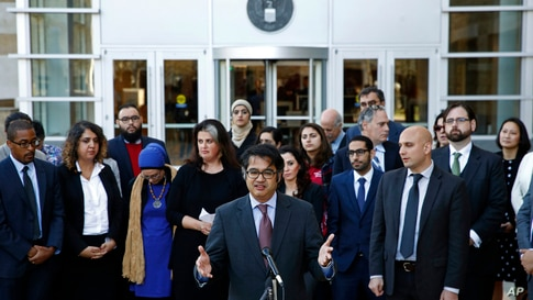 Omar Jadwat, center, director of the ACLU's Immigrants' Rights Project, speaks at a news conference outside a federal courthouse in Greenbelt, Maryland, Oct. 16, 2017, following a hearing regarding three lawsuits over the Trump administration's restr...