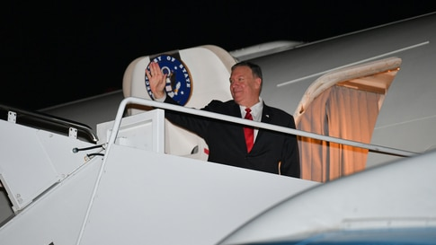 U.S. Secretary of State Mike Pompeo waves before boarding his plane departing from Andrews Air Force Base in Maryland, Sept. 17, 2019.