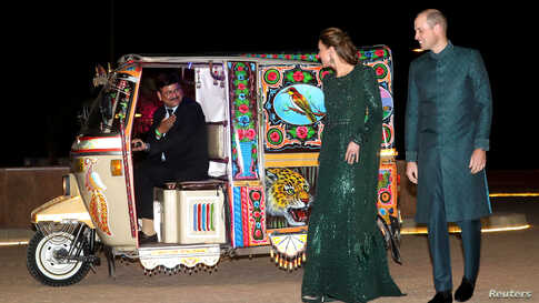 Britain's Prince William and Catherine, Duchess of Cambridge, arrive by Tuk Tuk to attend a reception hosted by the British High Commissioner to Pakistan, Thomas Drew, at the Pakistan National Monument in Islamabad.