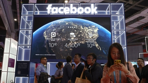 Visitors past by the booth for social media giant Facebook at the China International Import Expo in Shanghai, Nov. 6, 2019.