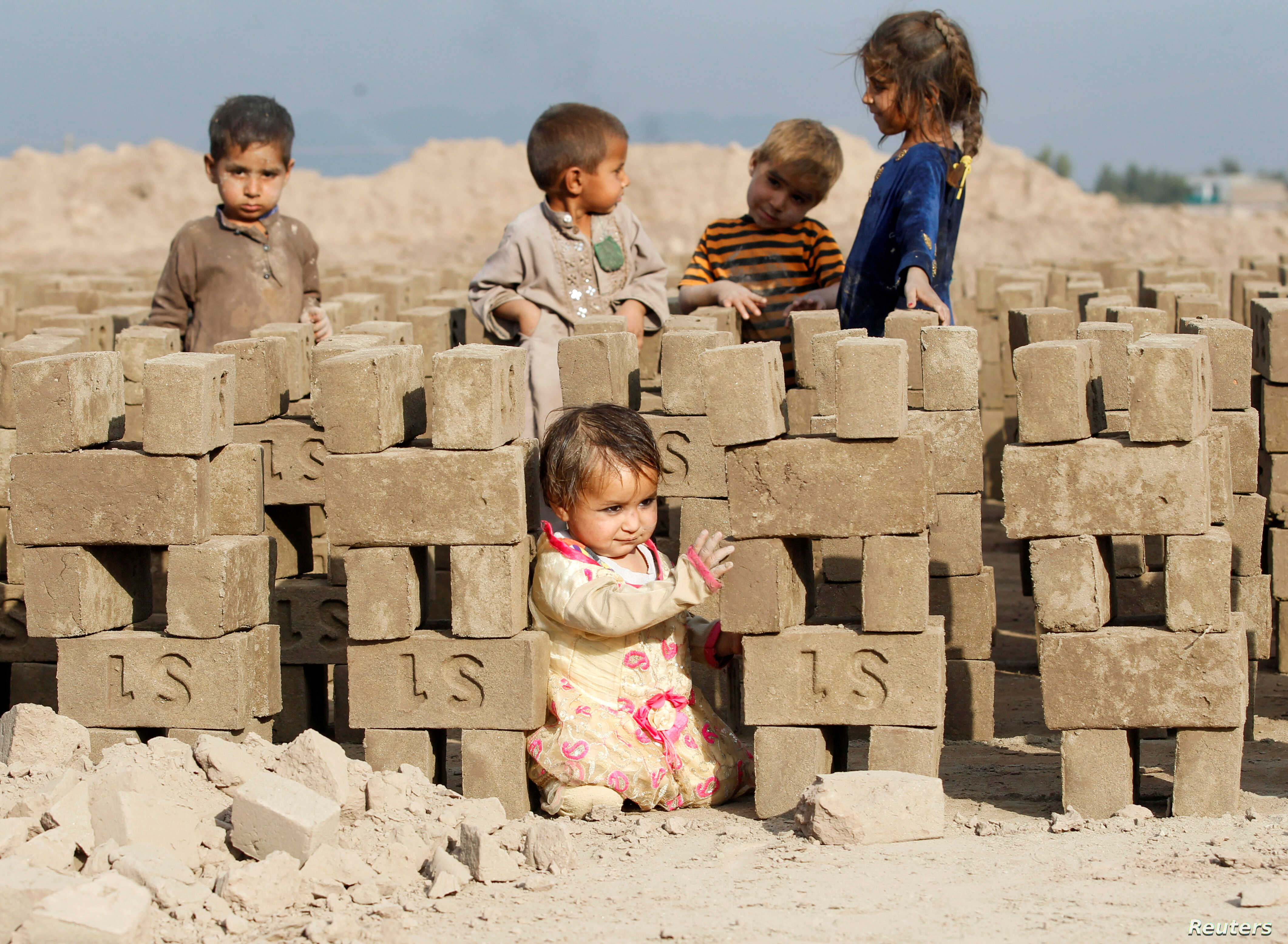 Children play at a brick-making factory on the outskirts of Jalalabad, Afghanistan.