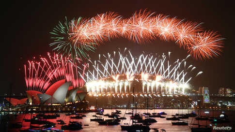The midnight fireworks are seen during New Year's Eve celebrations in Sydney, Australia.