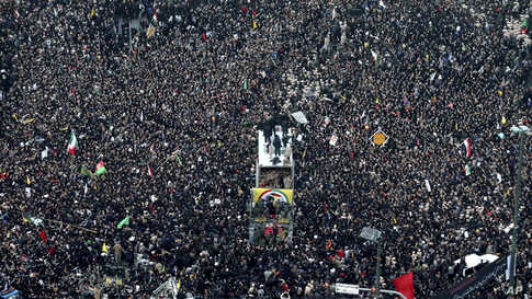 Coffins of Gen. Qassem Soleimani and others who were killed in Iraq by a U.S. drone strike, are carried on a truck surrounded by mourners during a funeral procession, in the city of Mashhad, Iran, Jan. 5, 2020.