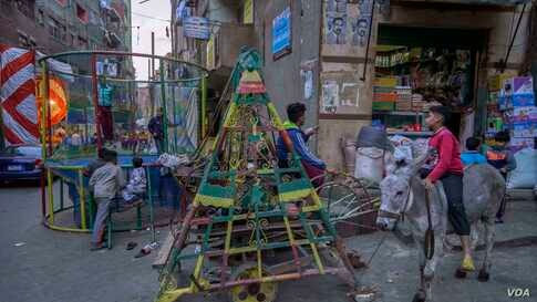 In Cairo's Garbage City, Coptic children enjoy time off from school during the holiday. (Hamada Elrasam/VOA)
