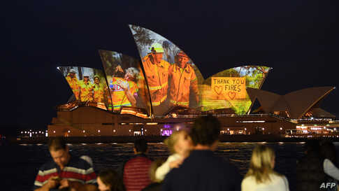 The sails of the Opera House are lit with a series of images to show support for the communities affected by the bushfires and to express the gratitude to the emergency services and volunteers in Sydney, Australia, Jan. 11, 2020.