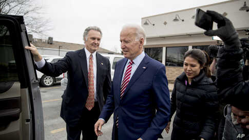 Democratic presidential candidate Joe Biden leaves after eating lunch at a restaurant in Bettendorf, Iowa, Jan. 6, 2020.