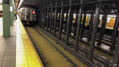 A subway train sits on flooded tracks at 66th Street, Monday, Jan. 13, 2020, in New York.