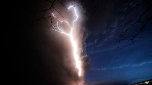 Lightning flashes as Taal Volcano erupts, Jan. 12, 2020, in Tagaytay, outside Manila, Philippines.