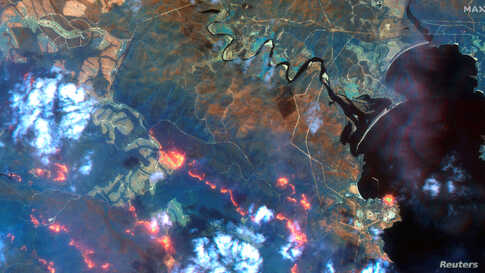 A view shows fire lines south of Eden, New South Wales, Australia, in this handout Maxar's WorldView-3 satellite image taken on Jan. 12, 2020.