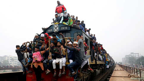 Thousands of muslims return home on an overcrowded train, after attending the final prayer of Bishwa Ijtema, which is considered the world's second-largest Muslim gathering after Haj, in Tongi, outskirts of Dhaka, Bangladesh.