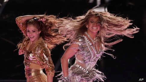 Singers Shakira and Jennifer Lopez perform during the halftime show at the NFL Super Bowl 54 football game