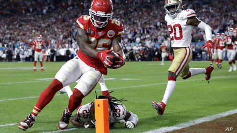 Kansas City Chiefs' Damien Williams (26) scores a touchdown against the San Francisco 49ers during the second half