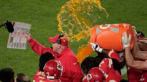 Kansas City Chiefs' players pour a cooler of Gatorade on head coach Andy Reid, during the second half of the NFL Super Bowl 54 football game against the San Francisco 49ers, Sunday, Feb. 2, 2020, in Miami.