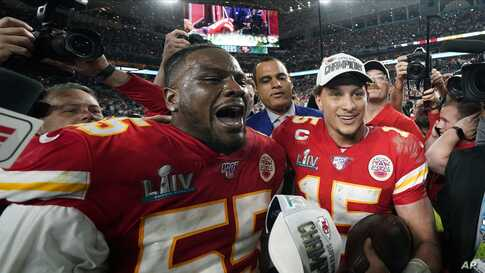 Kansas City Chiefs Frank Clark, left, and Patrick Mahomes celebrate after the Chiefs defeated the San Francisco 49ers.