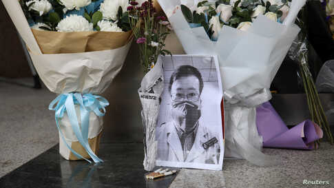 A makeshift memorial for Li Wenliang, a doctor who issued an early warning about the coronavirus outbreak before it was officially recognized, is seen after Li died of the virus, at Central Hospital of Wuhan in Hubei province, China Feb. 7, 2020.