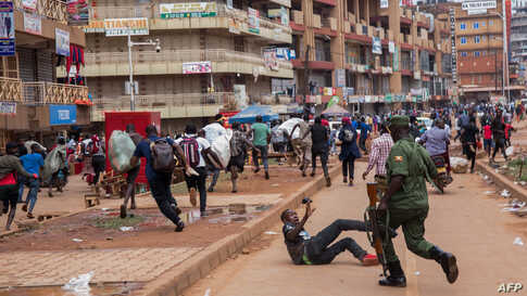 A police officer chases street vendors in Kampala, Uganda, after President Yoweri Museveni directed the public to stay home for 32 days starting to curb the spread of the coronavirus.