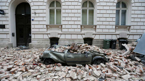 A destroyed car is seen following a 5.3 magnitude earthquake in Zagreb, Croatia.
