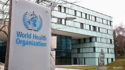 FILE PHOTO: A logo is pictured outside a building of the  World Health Organization (WHO) during an executive board meeting on…