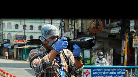 Agence France Presse photographer Diptendu Dutta works in India on April 10, 2020, during a government-imposed nationwide lockdown to prevent the spread of the COVID-19 coronavirus.