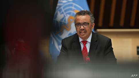 This handout image provided by the World Health Organization (WHO) on May 22, 2020 in Geneva shows WHO Director-General Tedros…