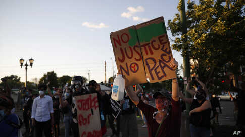 Demonstrators gather Thursday, May 28, 2020, in St. Paul, Minn.,  over the death of George Floyd.