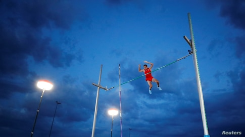 Germany's Karsten Dilla in action during the pole vault in Dusseldorf, Germany, June 12, 2020.