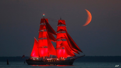 A brig with scarlet sails travels on the Finnish Gulf coast during a rehearsal for the the Scarlet Sails festivities marking…