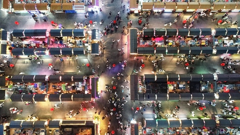 This aerial photo shows people visiting a night market in Shenyang in China's northeastern Liaoning province, June 16, 2020.