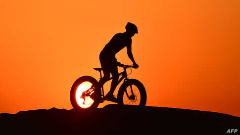 A cyclist rides in al-Qudra desert in the Gulf emirate of Dubai, United Arab Emirates, June 8, 2020.