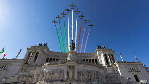 This handout photo by the press office of the Quirinale presidential palace shows the Italian Air Force acrobatic unit flies over the Vittorio Emanuele II National Monument as part of Republic Day ceremonies.