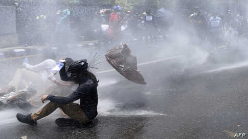 Police use water cannon to disperse demonstrators protesting against the government's policy on the fight against the COVID-19 situation, in Kathmandu, Nepal.